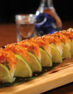 Wasabi Chi - The Des Moines Monster Roll consists of spicy smoked crab, mango, cucumber and salmon, topped with honey miso sauce and Japanese spices.