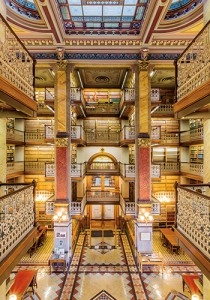 """The State Law Library of Iowa occupies a dazzling space in the Capitol's west  wing. The atrium towers to nearly 50 feet.  The exact origins of the tile used in the library are unknown, law librarian Cory Quist says. """"Some say England. Some say Italy. We just know they're from somewhere in Europe,"""" he says. Some years ago, when the state considered adding electric outlets for laptop users, it was learned that the tiles are essentially irreplaceable, Quist adds."""