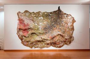 """El Anatsui, """"Basin"""" (2012), found aluminum and copper wire, 134 × 160 inches."""