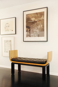 A lithograph by renowned artist Jasper Johns hangs over a 1929 bench by  Eliel Saarinen. On the wall to the left is a woodcut by Italian artist Francesco Clemente (top) and a lithograph by American artist Richard Diebenkorn.
