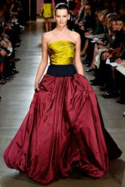 This gown by the late Oscar de la Renta is a perfect example of how New York designers are using more fabric in their designs.