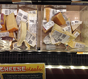 The bargain bin at Whole Foods makes it easy to sample new cheeses.