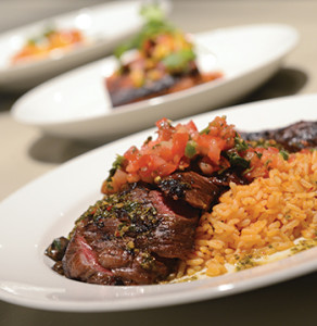 The rosy-pink slices of grilled carne asada.