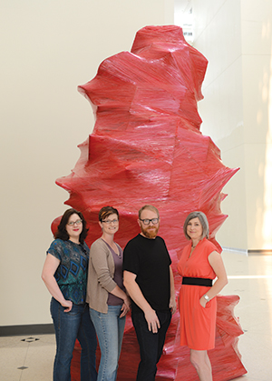 From left: Laura Burkhalter, Staci Nevinski, Mat Greiner and Larassa Kabel founded Chicken Tractor as a way to help increase opportunities for local artists.