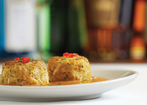 """""""Lump"""" rarely makes the cut as an adjective for food on a restaurant menu, but Fleming's makes an exception for its jumbo lump crabcakes with roasted red pepper and lime butter sauce."""