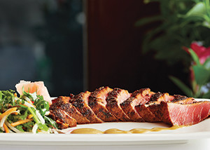 Seared ahi tuna, served with a fresh vegetable salad and spicy mustard sauce, is on the menu's list of small plates.