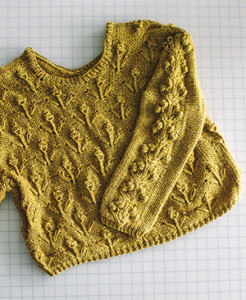 Lauren Pearson spent 60 hours creating this hand-knit sweater, part of her collection that won the top honor at Iowa State University's annual fashion show last year.