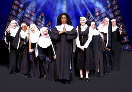 """Alexanda Grey, center, plays a disco diva hiding from criminals in a convent in """"Sister Act."""" In song and dance, she leads the church through a new reformation."""