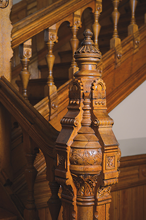 The lustrous patina of time embellishes ornamentation on this newel post and balustrade in the 1884 Sheuerman House, now owned by York Taenzer.
