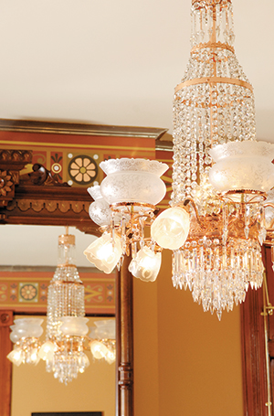 An elaborate chandelier serves as a brilliant centerpiece for this parlor in the 1881 Maish House on Center Street, now the home of Marty Gross.