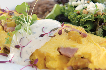 The squash omelet at Le Jardin features tender acorn squash and smoky ham, with a touch of brie and crème fraîche for added lusciousness. Photo by Duane Tinkey.