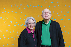 "Married 41 years, Trudy and Tom Dolezal are the museum's only husband-and-wife team. Larry Poons, ""Han-San Cadence"" (1963); acrylic and fabric dye on canvas,  72 1/2 x 144 7/8 x 2 5/16 inches."