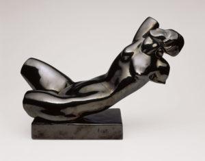 "Working in ceramic with black glaze, Alexander Archipenko created ""Reclining Torso"" in 1921. © 2015 Estate of Alexander Archipenko/Artists Rights Society (ARS), New York"